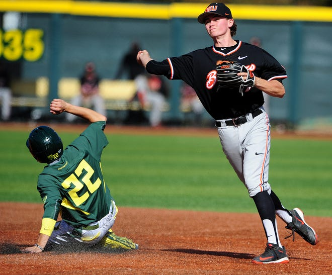 Oregon State shortstop Trever Morrison, seen here turning a double playing during a game in 2015, was selected with the sixth pick overall in the inaugural draft of the Mavericks Independent Baseball League. He was drafted by the Campesinos de Salem-Keizer.