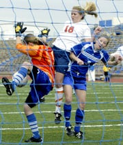 Central's Morgan Barnett (center) tries to get off a shot against the defense of Lake View goalkeeper Sarah Pipkin and Amber McCall during a scrimmage at San Angelo Stadium on Jan. 3, 2003.