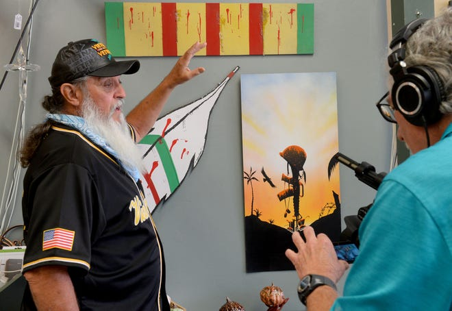 "Veteran Orlando Menchaca, left,  talks to George Sandoval, project coordinator of the ""Leave No One Behind Mural Project,"" on Thursday, April 15, 2021. The show opens Saturday at the Corner Cottage in Santa Paula."