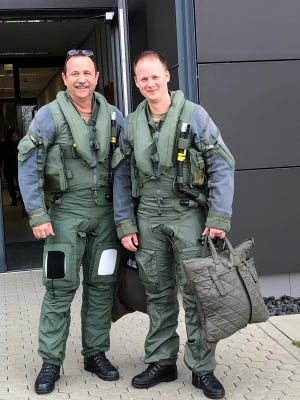 Lt. Col. Siegfried Beck, left, will pin the ENJJPT wings he earned 31 years ago on his son, Tobias. Both men are officers in the German Air Force