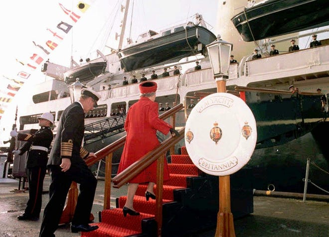 Queen Elizabeth II and Prince Philip board The Royal Yacht Britannia on Dec. 11, 1997, at Portsmouth before the vessel was retired after 44 years service. The monarch was reported to have been teary as she toured the rooms one last time.