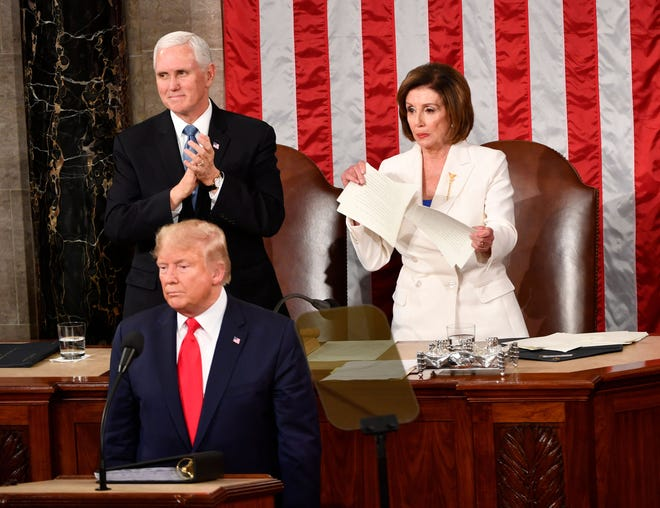Speaker of the House Nancy Pelosi rips up the speech after President Donald J. Trump concludes delivering the State of the Union address from the House chamber of the United States Capitol in Washington on Feb. 4, 2020.