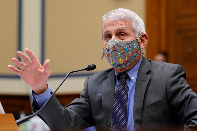 Dr. Anthony Fauci, the nation's top infectious disease expert, responds to a question from Rep. Jim Jordan, R-Ohio, during a House Select Subcommittee hearing on Capitol Hill in Washington, Thursday, April 15, 2021, on the coronavirus crisis.