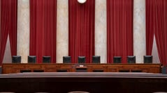 FILE - In this June 24, 2019 file photo, the empty courtroom is seen at the U.S. Supreme Court in Washington. On Monday, May 4, 2020, the Supreme Court for the first time audio of court's arguments will be heard live by the world and the first arguments by telephone. (AP Photo/J. Scott Applewhite, File) ORG XMIT: WX103