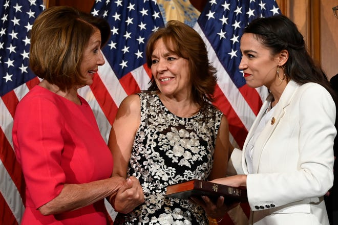 House Speaker Nancy Pelosi talks with Rep. Alexandria Ocasio-Cortez, D-N.Y., right, and her mother Blanca Ocasio-Cortez, center, during a ceremonial swearing-in on Capitol Hill in Washington, Thursday, Jan. 3, 2019, during the opening session of the 116th Congress.