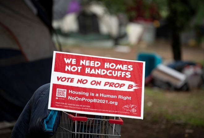 An anti-Prop B sign in a homeless camp in the median of East Riverside Drive on April 16. [AMERICAN-STATESMAN/FILE]