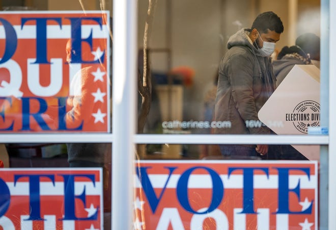 A voter is shown last fall at a voting center at Southpark Meadows. Early voting runs from April 19-27 for the May 1 city election.