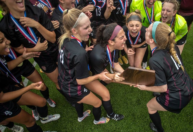The Dripping Springs girls soccer squad celebrates its 2-1 win over Frisco Wakeland in the Class 5A state championship game at Georgetown on Friday. The Tigers finished the season with a 27-1-1 record.