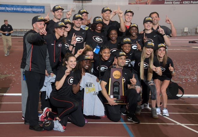 Mar 10, 2018; College Station, TX, USA; Members of the Georgia Bulldogs women's team and coach Petros Kyprianou celebrate after winning the team title during the NCAA Indoor Track and Field Championships at the McFerrin Athletic Center. Mandatory Credit: Kirby Lee-USA TODAY Sports