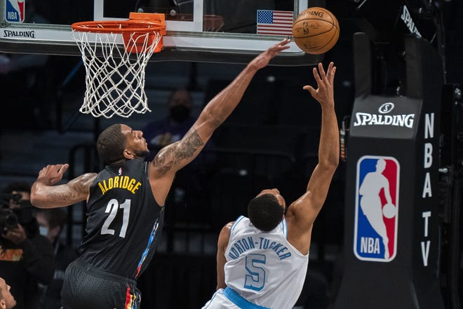Texas ex LaMarcus Aldridge blocks Los Angeles Lakers guard Talen Horton-Tucker's shot in the first half of last Saturday's game in New York. It turned out to be Aldridge's last game. He announced his retirement Thursday due to an irregular heartbeat after 15 seasons playing for three teams.