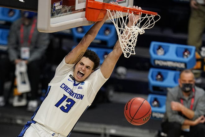 Creighton forward Christian Bishop (13) follows through on a dunk against Ohio in the second half of a second-round game in the NCAA men's college basketball tournament at Hinkle Fieldhouse in Indianapolis, Monday, March 22, 2021.