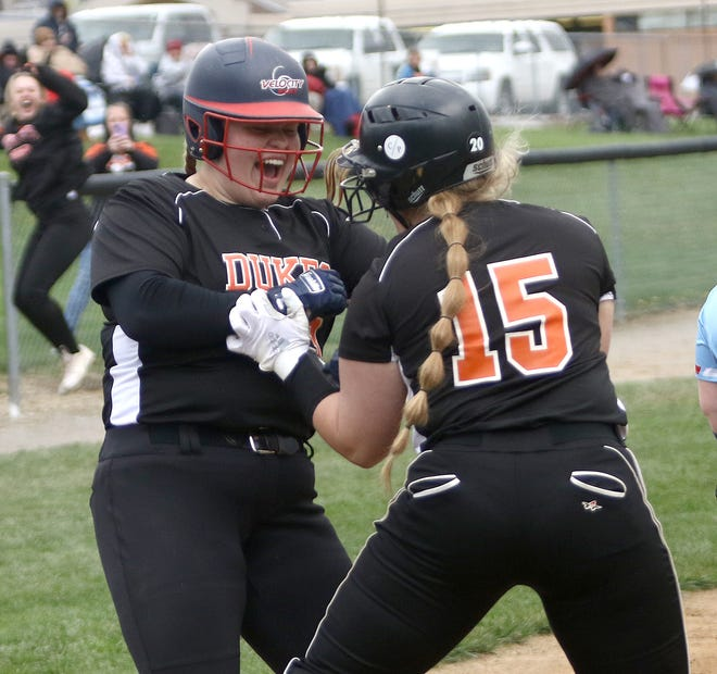 Marlington's Emma Jackson, right, celebrates with Ashlyn Maurer at home plate after Maurer's inside the park grand slam during league play at Marlington High School, Thursday, April 15, 2021. Ed Hall Jr, Special to The Review