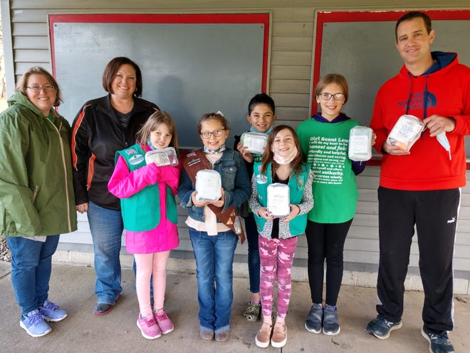 Eric Stitzlein, right, accepts first aid kits made by members of Loudonville Girl Scout Troop 4183 on April 15. Making the presentation are leaders Heidi Schoener and Jessica Matz and Scouts Anora Schoeneer, Chloe Matz, Tessa Cutburth, Makenna Cutburth and Marlie Spring.