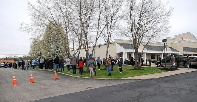 People wait in line outside at the COVID-19 vaccine clinic at UH Samartian in Ashland this spring. As of Aug. 23, about 33 percent of Ashland County residents are fully vaccinated. Times-Gazette file photo