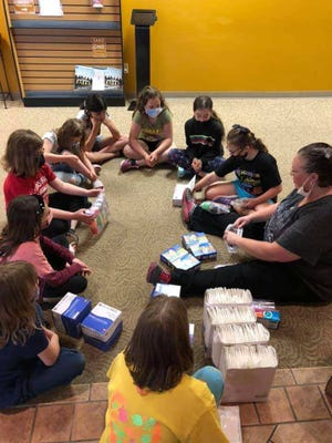 After learning to put together first aid kits recently at the Loudonville Fire Department, Girl Scouts in Troop 4183 assemble them in a circle.