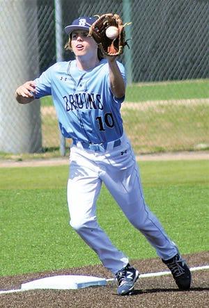 Bartlesville High School third baseman Hayden Catlin snares the ball during varsity baseball action earlier this season.