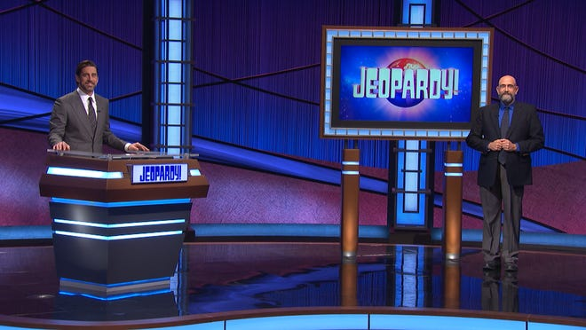 """Hyannis native Dennis Chase shares the """"Jeopardy!"""" stage with guest host Aaron Rodgers. [Courtesy of 'Jeopardy!']"""