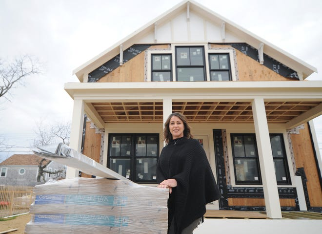 Jessica Smith is the project manager for REEF Builders, which is building this home on George Street in Barnstable. The West Dennis-based company has several pending permit applications in towns across Cape Cod that have been delayed as building departments are deluged with similar requests.