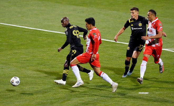 Columbus Crew SC forward Bradley Wright-Phillips (99) scores against Real Esteli FC defender Oscar Lopez (4) during the second half of their CONCACAF Champions League quarterfinals game at Crew Stadium on April 15, 2021.