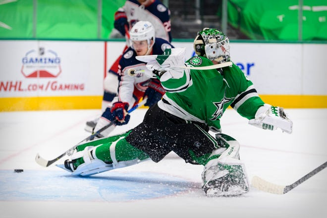 Apr 15, 2021; Dallas, Texas, USA; Columbus Blue Jackets center Jack Roslovic (96) scores a goal against Dallas Stars goaltender Jake Oettinger (29) during the first period at the American Airlines Center. Mandatory Credit: Jerome Miron-USA TODAY Sports