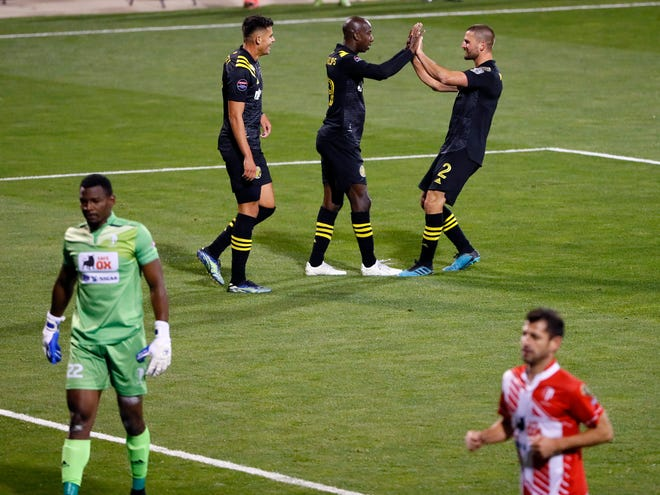 Columbus Crew SC forward Bradley Wright-Phillips (99) celebrates with Columbus Crew SC midfielder Perry Kitchen (2) after scoring against Real Esteli FC goalkeeper Denver Fox (22) during the second half of their CONCACAF Champions League quarterfinals game at Crew Stadium on April 15, 2021.