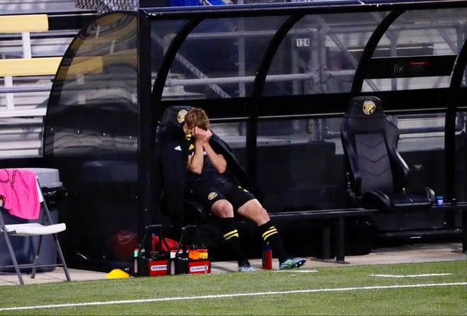 Columbus Crew midfielder Aidan Morris sits on the sideline after injuring his knee in the first half of the second leg against Real Esteli FC.