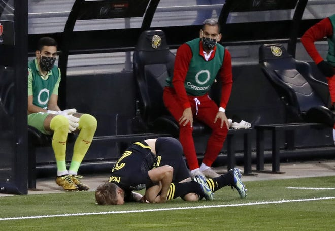 Crew midfielder Aidan Morris clutches his left knee after suffering a non-contact injury in the opening minutes of Thursday's CONCACAF Champions League win over Real Esteli FC.