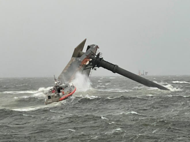 Rescuers search for missing crew members near the capsized Seacor Power after it capsized April 13 about 8 miles south of Port Fourchon.