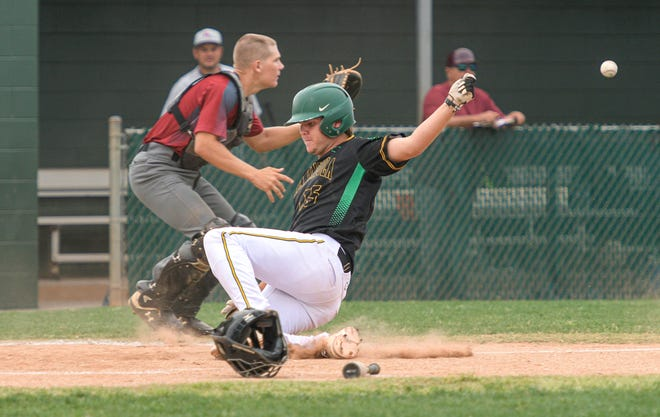 Lake Minneola's Daniel Marinacci (15) slides into home plate at a game during Thursday's game against Real Life Christian Academy in Minneola. [PAUL RYAN / CORRESPONDENT]