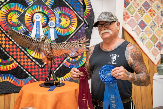Probably the most unique piece submitted to the Lake County Fair was by artist Al Paquette of Umatilla. His sculpture of an eagle is made out of 150 butter knives, 45 spoons, 40 forks and a trailer hitch.  [Cindy Peterson/Correspondent]