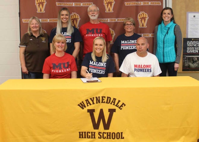 Surrounded by family and friends, Sara Ice celebrates signing with the Malone University to play college volleyball. Ice was one of the top volleyball players in the area during her prep career and will be a nursing major in college.