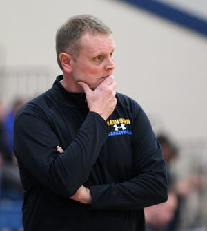 Rick McNeil looks onto the floor during a game in the 2015 season as Madison head coach.