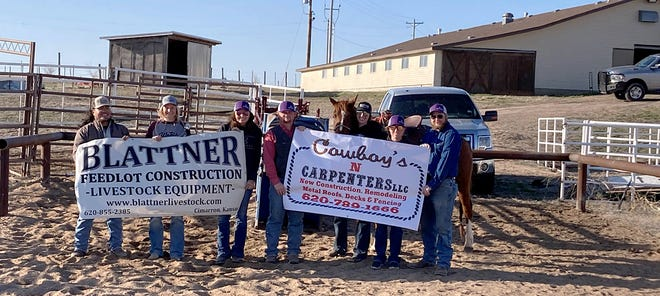 Members of the DCCC rodeo team pose with banners representing two of the three donors who provided the new roping boxes at the DCCC Rodeo Practice Arena. The area businesses involved with the project were Blattner Feedlot Construction & Livestock Equipment, Cowboys 'N' Carpenters LLC and Mead Lumber.