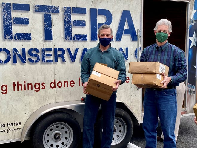 Gov. John Carney and DNREC Secretary Shawn Garvin unload some of the approximately 2,000 pounds of plastic bags that were delivered by Delaware State Parks to Eco Plastic Products of Delaware April 15. The bags, which are left over from when Delaware State Parks switched to corn and paper products for its Carry-in, Carry-out program in 2020, will be made into benches for the state parks.