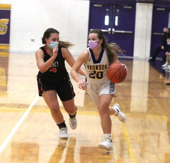 Bronson senior Meagan Lasky, shown here being guarded by fellow All Conference First Teamer Hannah Clark of Quincy, earned Big 8 All Conference First Team honors.