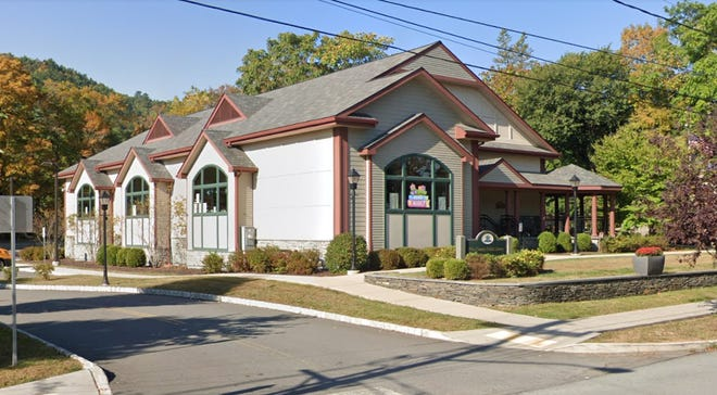E-BOOKS MORE POPULAR THAN EVER - Pike County Public Library Director Rose Ciocchi said that although in-person attendance is down - since the pandemic began - use of electronic resources including e-books and e-audio books has nearly doubled. The Milford branch at 119 East Harford Street is pictured. Both the Milford and Dingman branches are open and patrons are welcome; face masks are needed.