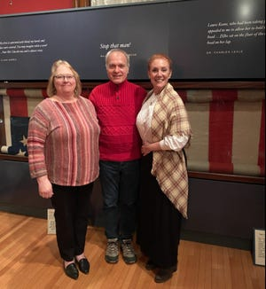 From left: Pike County Historical Society Curator and writer Lori Strelecki, ART Director Jeffrey Stocker, and actor Patricia Durante stand in front of the famed Lincoln Flag at the Columns Museum.