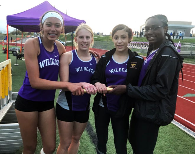 The Blue Springs' 1,600 (4x400) relay team of Olivia Dixon, Noema Wild, Gwen Deterding and Ariana Jackson celebrate their win in the Gary Parker Invitational Thursday at Peve Stadium. They helped the Wildcats finish second, just two points behind champion Columbia Rock Bridge.