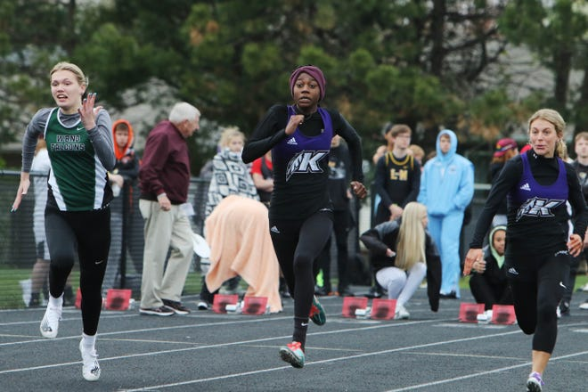 From left West Burlington-Notre Dame's McKenna Marlow, Keokuk High School's Miracle Ailes and Lindsey Campbell run the the second heat of the girls 100 meter dash during the Denny White Relays Thursday April 15, 2021, at the Mapleleaf Athletic Complex in Mount Pleasant.