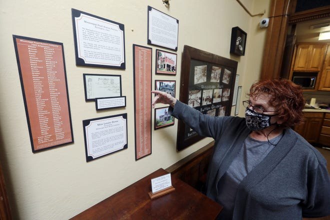 Robin Schneiderman, executive director of the Des Moines County Heritage Museum, talks Friday about the Mississippi Pearl Button Factory display located in the new upper-level Family Story Gallery exhibit space at the Burlington museum located at 501 N. Fourth St. The museum, which has been shuttered since mid-March 2020 when a proclamation from Gov. Kim Reynolds closed all museums in the state, will reopen June 22, and be open from 10 a.m. to 3 p.m. Tuesday through Saturday.