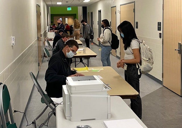Dover Fire and Rescue members register Dover High School students for a vaccination clinic held at DHS today, April 15.