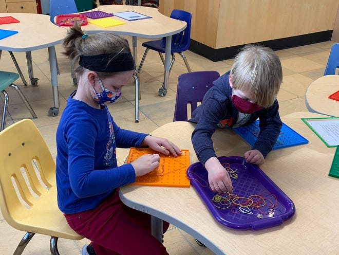 Children work on a STEAM challenge at the Children's Museum of New Hampshire in Dover.