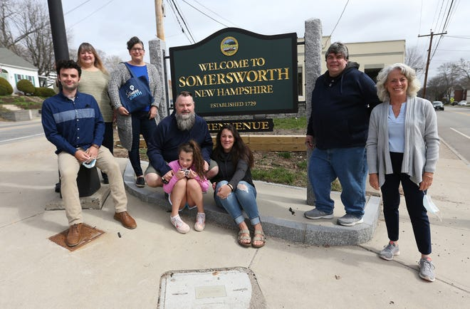 Somersworth business owners and other citizens are excited about making the 10-square-mile city a destination which offers unique experiences and goods. From left are Ed Levasseur, Paula Tsiorbas, Dina Gagnon, Matt and Carolyn Caffelle and daughter Taylor, Don Berrios and Robin Comstock.