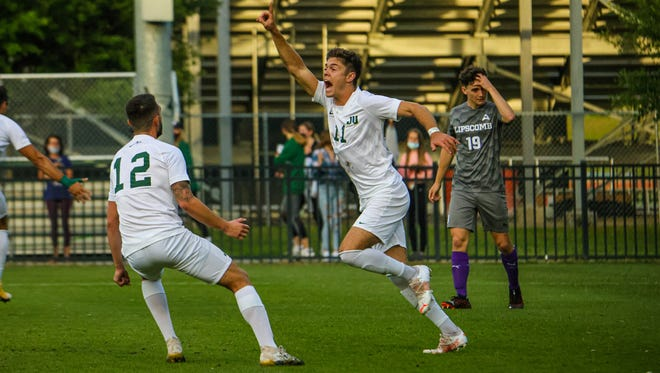Jacksonville University's Jake Johnson (11) celebrates his goal with teammate Joshua Moreira to give the Dolphins the lead in an ASUN semifinal game against Lipscomb at Southern Oaks Stadium on Thursday.