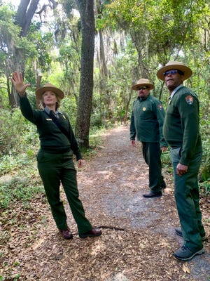 Chris Hughes (center), superintendent of the Timucuan Ecological and Historic Preserve, and National Park Service rangers Corinne Fenner and Ted Johnson led Times-Union columnist Mark Woods on a leg of his walk across Jacksonville — through the Theodore Roosevelt Area.