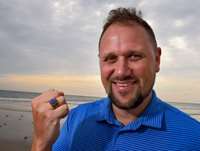 Dwight Cenac displays his class ring that was returned to him 20 years after he lost it while flying from Jacksonville to Los Angeles. It turns out the graduation ring, from Seacoast Christian Academy in Jacksonville, had somehow made it into the waters off Honduras.