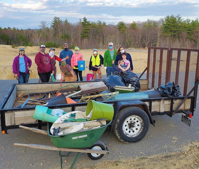 A group of approximately 30 volunteers recently showed up to remove rubbish from the Ebenezer Keyes Conservation Area, owned by North County Land Trust, in Gardner. A container donated by E.L. Harvey & Sons Inc. was filled in two hours time.