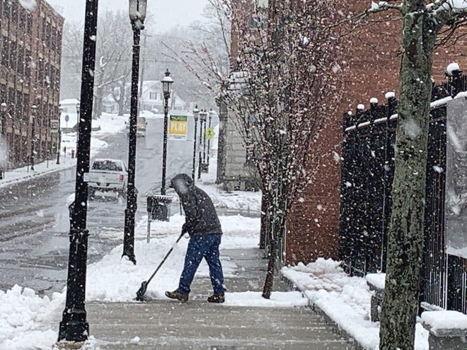 Snow cleanup gets underway on Central Street in Gardner on April 16.