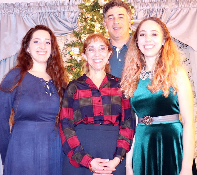 Former Gardner High slugging catcher Matt Whipple now resides in Charlton with his wife Joanne, center, and daughters Kelsey and Rachel. Missing from the photo are Matt and Joanne's son, Brendan.