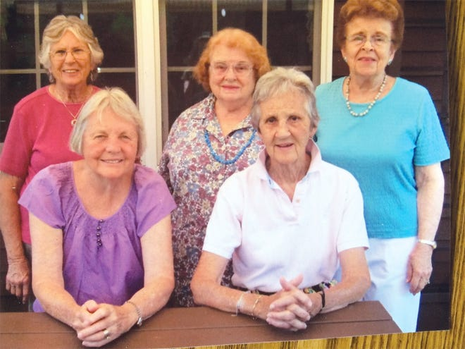 Lifelong friends pose for a photo — front row: Carole Gariepy and Sandy Allen; back row: Mary Alice Pollard, Betty Snyder and Shirley Avery.